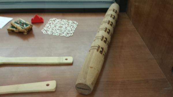 Display case in maker area with laser etched rolling pin
