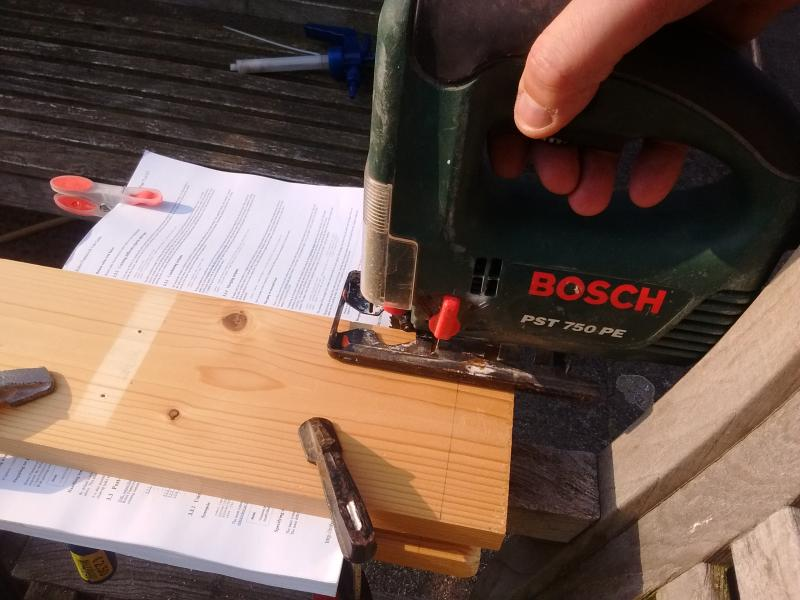 Clamping the book and cut in half with a Jig Saw