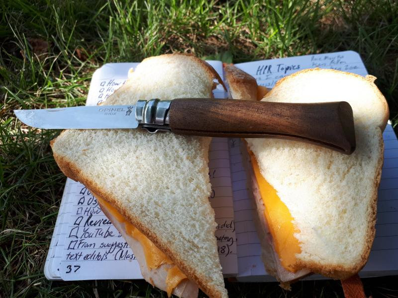 Opinel pocket knife with ham and cheese sandwich