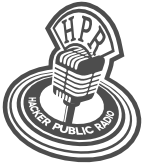 An old style microphone with a red circle showing the words Hacker Public Radio